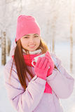 Beautiful girl with cup outdoor Stock Photography