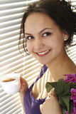 Beautiful girl with a cup of tea Royalty Free Stock Image