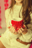 Beautiful girl with a cup of tea Stock Images