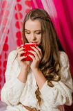 Beautiful girl with a cup of tea Royalty Free Stock Images