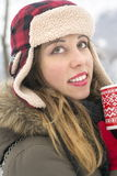 Beautiful girl with cup of tea on snowy day Stock Photo