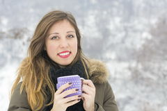 Beautiful girl with cup of tea on snowy day Royalty Free Stock Photos