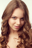 Beautiful girl with curled hair Royalty Free Stock Photo