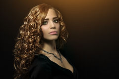 Beautiful girl with curly hair Royalty Free Stock Image