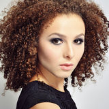 Beautiful girl with curly hair - close up Royalty Free Stock Images