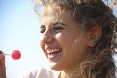 Beautiful girl curly hair joyful portrait with candy sky emotions. Beautiful girl curly hair portrait  candy sky emotions joyful Royalty Free Stock Image