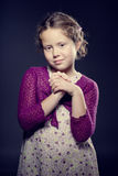 Beautiful girl with curly hair posing in a studio Royalty Free Stock Photography