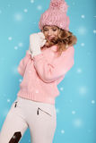 Beautiful girl with curly hair  in warm cozy winter clothes Stock Photos