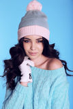 Beautiful girl with curly hair  in warm cozy winter clothes Royalty Free Stock Photos