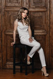 Beautiful girl with curly hair in a white suit Royalty Free Stock Images