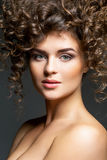 Beautiful girl with curly hairdo Stock Images