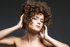 Beautiful girl with curly hairdo Royalty Free Stock Photo