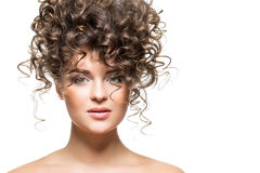 Beautiful girl with curly hairdo Royalty Free Stock Image