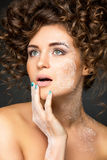 Beautiful girl with curly hairdo Royalty Free Stock Photos