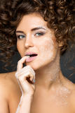 Beautiful girl with curly hairdo Royalty Free Stock Images