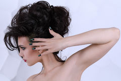 Beautiful girl with curly hairstyle perfect manicure and make-up Royalty Free Stock Images