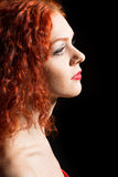 Beautiful girl with curly red hair Royalty Free Stock Photo