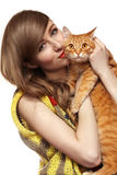 Beautiful girl with cute ginger cat. Love home pets. Beautiful girl in nice retro knitted sweater is holding ginger cat. Care about animals and love home pet Royalty Free Stock Images