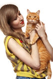 Beautiful girl with cute ginger cat. Love home pets. Beautiful girl in nice retro knitted sweater is holding ginger cat. Care about animals and love home pet Stock Photo