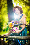 Beautiful girl with cute hat and basket with flowe Stock Images