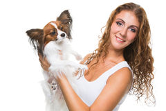 Beautiful girl with cute papillon dog on isolated white Royalty Free Stock Images