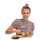 The beautiful girl cuts apples for pie. The beautiful girl the blonde cuts apples for pie in kitchen Stock Images