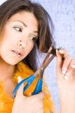 Beautiful girl cutting her hair Royalty Free Stock Image
