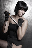Beautiful girl with a dagger Stock Photography