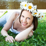 Beautiful girl with daisy wreath on her head Stock Image