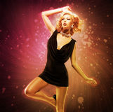 Beautiful girl dancer in black dress in creative pose over art royalty free stock image