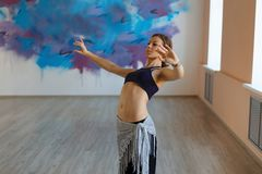 Beautiful girl dancer dancing on the move, tribal fusion. Beautiful dancer dancing on the move, tribal fusion in the studio royalty free stock photography