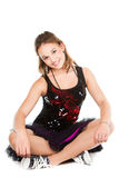 Beautiful girl dancer sitting on the floor Stock Image