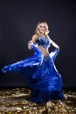 The beautiful girl dances and poses Royalty Free Stock Photography