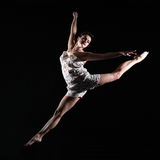 Beautiful girl dancing through the air Stock Images