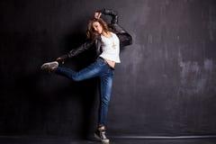 Beautiful girl dancing at black wall stock photos