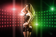 Beautiful girl dancing in club disco Royalty Free Stock Image