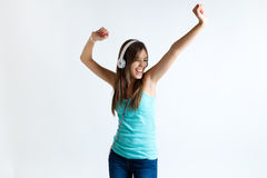 Beautiful girl dancing and listening to music. Isolated on white Royalty Free Stock Photography