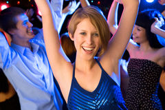 Beautiful girl dancing at a party Royalty Free Stock Images