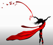 Beautiful girl dancing in red dress. With ribbons on a wind Royalty Free Stock Image