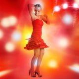 Beautiful girl is dancing in smoke and lights Stock Photos