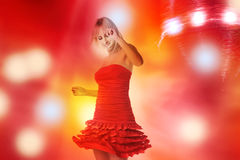 Beautiful girl is dancing in smoke and lights Stock Images