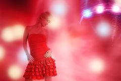 Beautiful girl is dancing in smoke and lights Royalty Free Stock Photo
