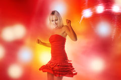 Beautiful girl is dancing in smoke and lights Royalty Free Stock Photography