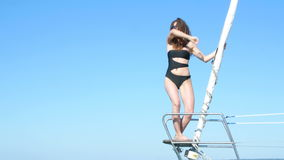 Beautiful girl dancing on a yacht - a bachelorette party.  stock video