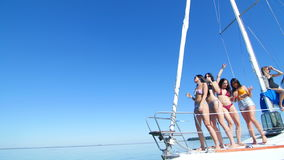 Beautiful girl dancing on a yacht - party and bachelorette party.  stock video footage