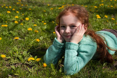 Beautiful girl with dandelions. Beautiful girl playing on meadow with dandelions Royalty Free Stock Image