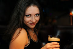 Beautiful girl with dark beer Royalty Free Stock Photography