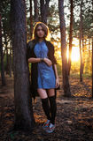 Beautiful girl is in the dark forest Stock Photo