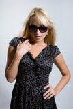 The beautiful girl in dark glasses Stock Image