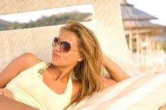Beautiful girl in dark glasses on the beach Stock Photo